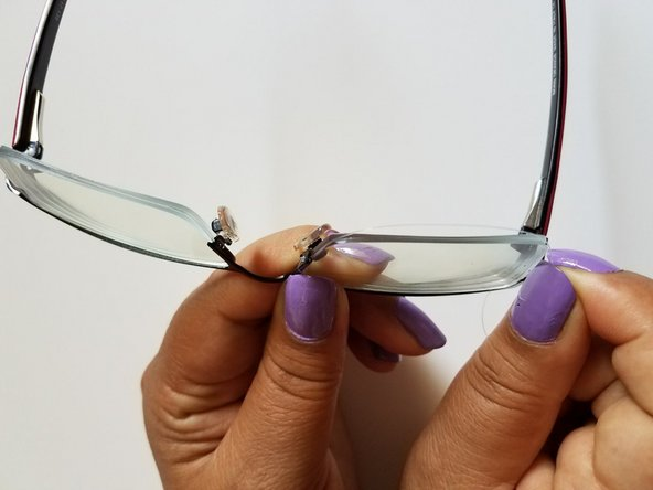 You will see a thin groove along the edge of the glasses. Carefully fix the wire around the groove as shown in the pictures.