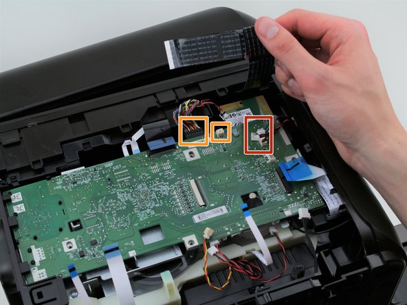 Remove the cables connected to the edge of the motherboard by gently pulling them out of their ports.