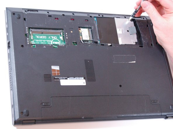 Image 1/3: Slide over the hard drive and remove it