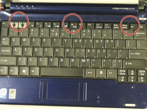 Image 2/2: Locate the three tabs at the top of the keyboard.