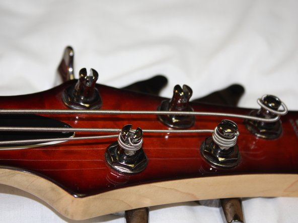 Caution: Do not over tighten the strings. This can cause the strings to snap and could cause bodily injury. The strings are too tight when you have difficulty turning the tuning peg.