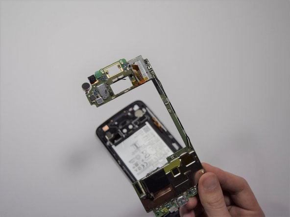 With your fingers, gently pry the rest of the motherboard up from the phone.