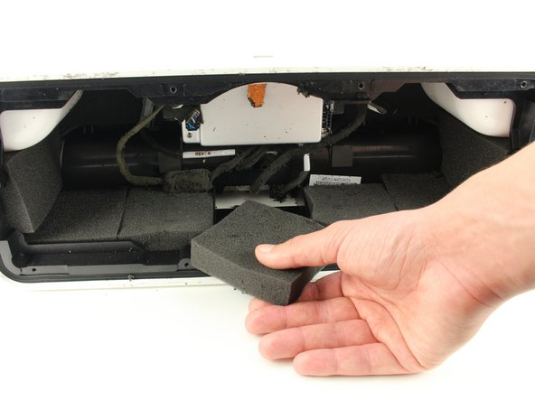 Remove the middle foam panel from the wall of the device closest to you by pulling the foam out with your hand.