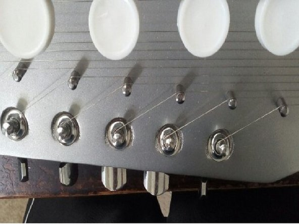 Image 1/1: You may use a guitar tuner to tune your strings.