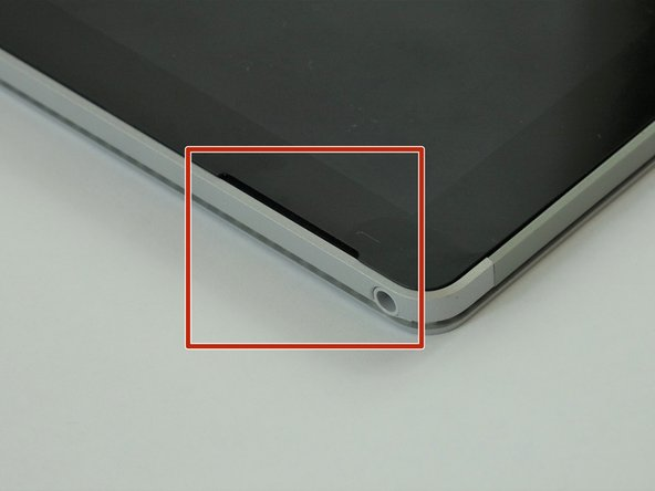 Place the Surface Book on a table with the camera towards you.  Place plastic spudgers in the indentations located on the top of the screen.  Use the iOpener to loosen up the adhesive.   opening picks from the iFixit Pro Kit work great here.  NOTE:  The speaker grills are cosmetic, don't worry about damaging them.