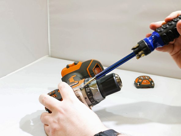 Remove the two 25mm T10 Torx screws from the front of the drill.