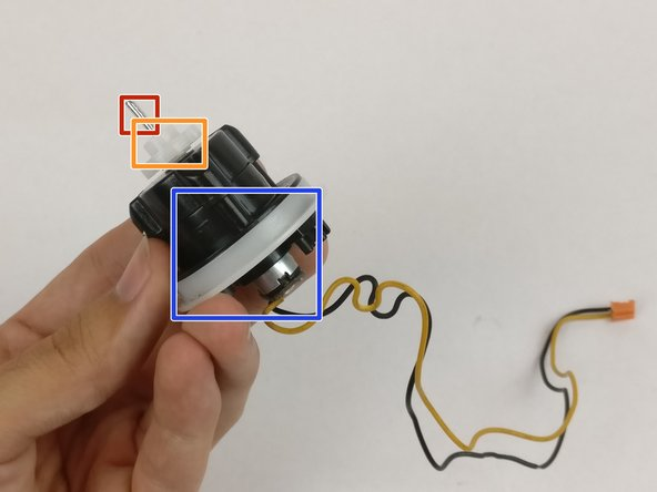 Remove pin (red), plastic piece connected to pin (orange), and plastic rim around motor (blue).