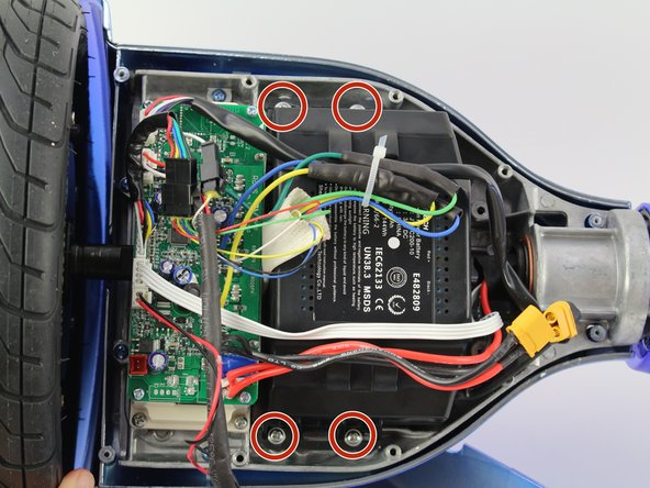 Using a Phillips #1 screwdriver, remove the four 14  mm screws that hold the battery on the device.
