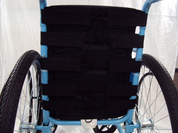 Place the bottom of the backrest against the back of the seat cushion.
