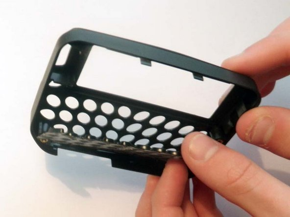 Flip the newly separated front portion of the casing over so that the front of the device is facing upwards, causing the keypad to fall loose.