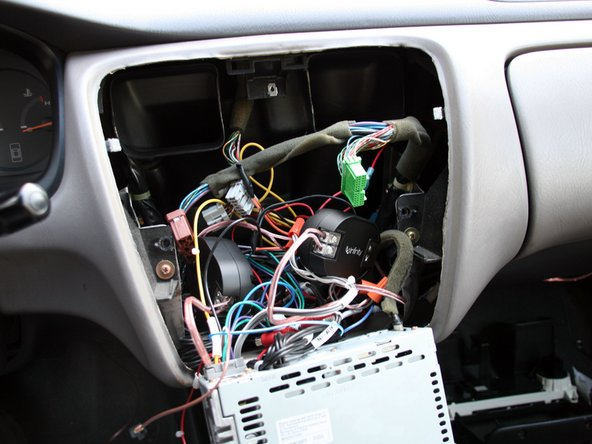 Carefully place the crossovers and wiring back into the dash, but don't close anything yet.