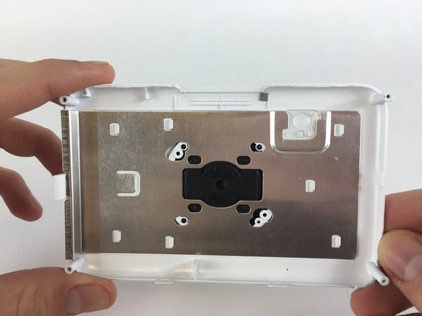Flip the front face-plate over, so that you're are looking at the silver plate on the inside.