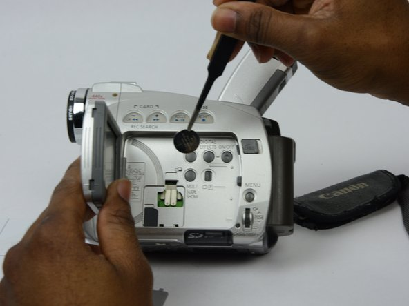 Use tweezers to carefully  pull out the LCD battery.