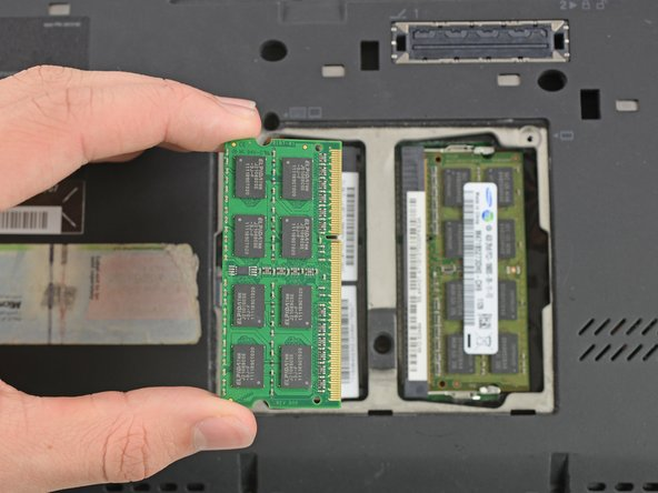 To remove the RAM, you need to pull the RAM into the shown direction out of its connector.