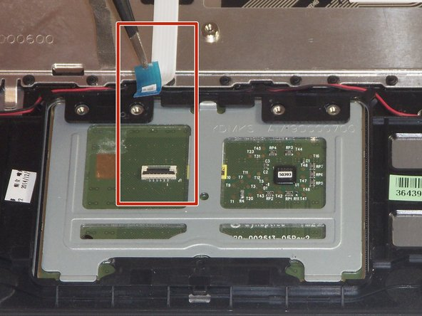 Use a pair of tweezers to disconnect the ZIF connector securing the trackpad ribbon cable. Gently lift up the black tab and the ribbon cable should come free.
