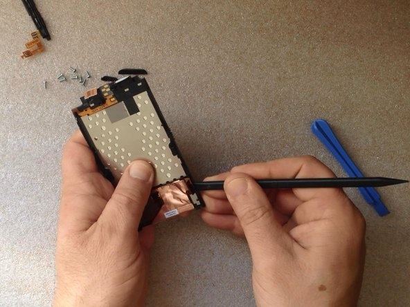 Use again hot air and carefully unstick the LCD Display flex cable from the frame.
