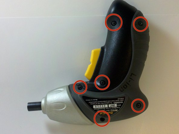 Image 1/3: Separate the screwdriver housing with a plastic opening tool.