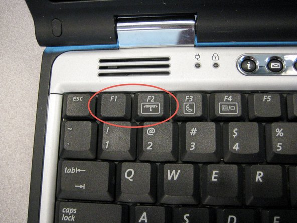 Locate the F1 and F2 keys near the top left corner of the keyboard.