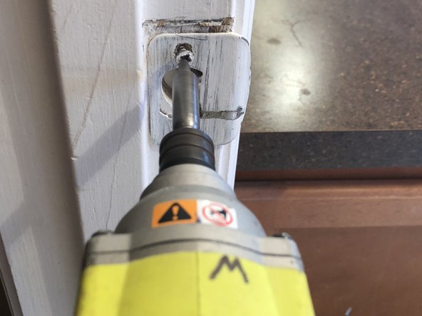 Use an electric power drill to remove the screws from your strike plate.