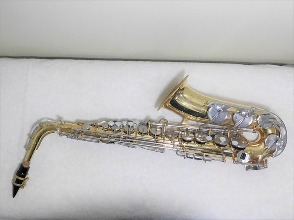 Put saxophone completely together and test out key.