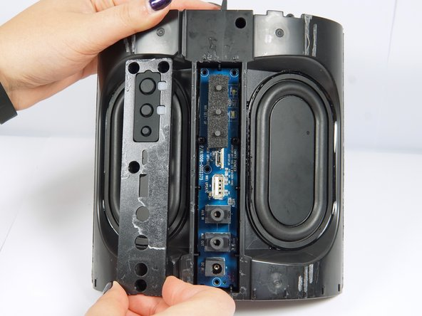 Remove the four 4 mm screws with a Phillips #2 screwdriver, then lift off the panel.