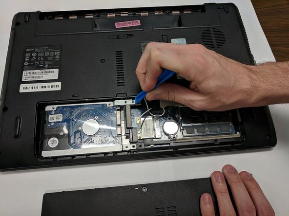 With a plastic opening tool slide the drive over and remove it.