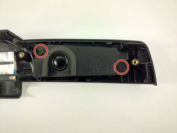 Remove the two 2.8mm screws on the left speaker housing using a Phillips screwdriver.