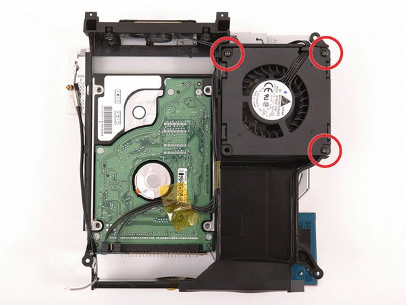 Image 1/1: Remove the three long, black Phillips screws from the corners of the fan. These screws are strongly threaded, and will offer significant resistance.