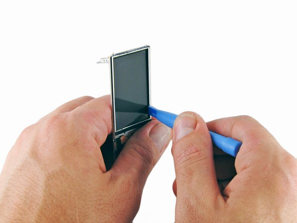 Insert an iPod opening tool between the front of the display and the metal frame on the right side of the display.