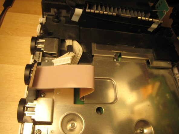 With those wires detached, the optical drive came off completely.