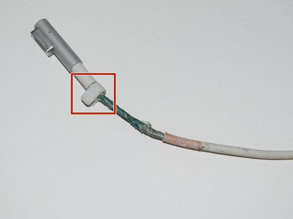 Move the wire connector away from the damaged or exposed area.