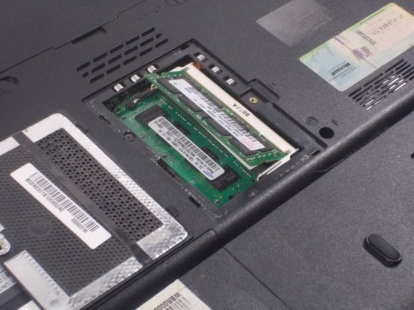 Image 3/3: The RAM stick should pop up at about a 30 degree angle.