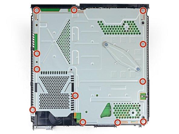 Remove the twelve 9.7mm Torx screws securing the upper EMI shield.
