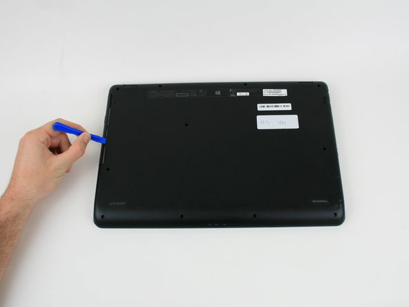 Using a plastic opening tool, pull the optical drive out of the computer by the seam.