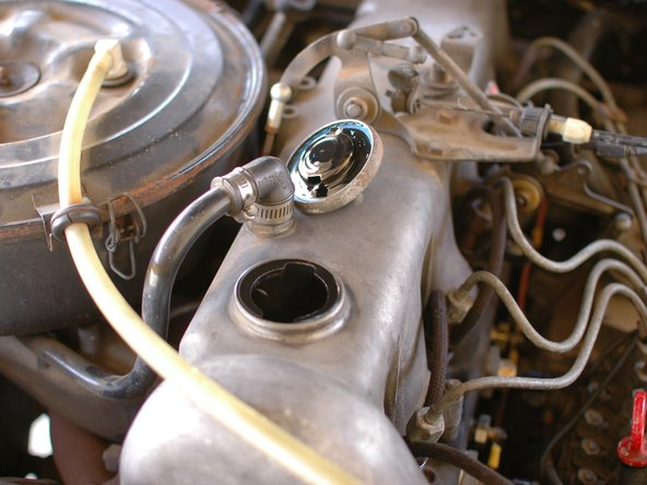 To start, remove the oil cap. This will allow the oil to drain out of the engine faster.