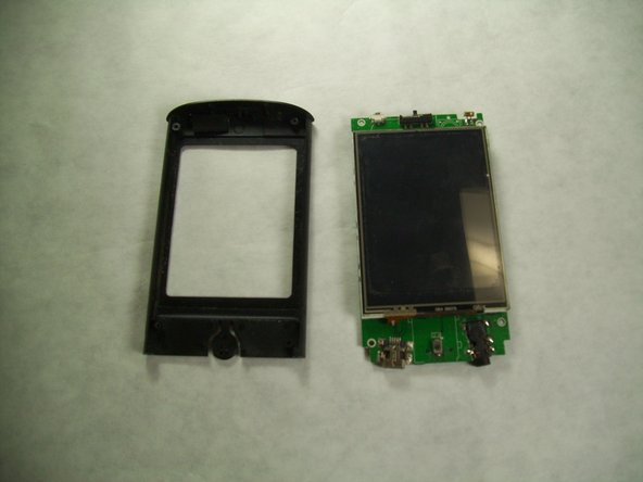 Remove the motherboard from the front plastic cover and screen.