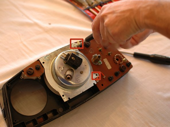 Image 1/1: Next, unscrew the two remaining screws holding the speedometer assembly in place.