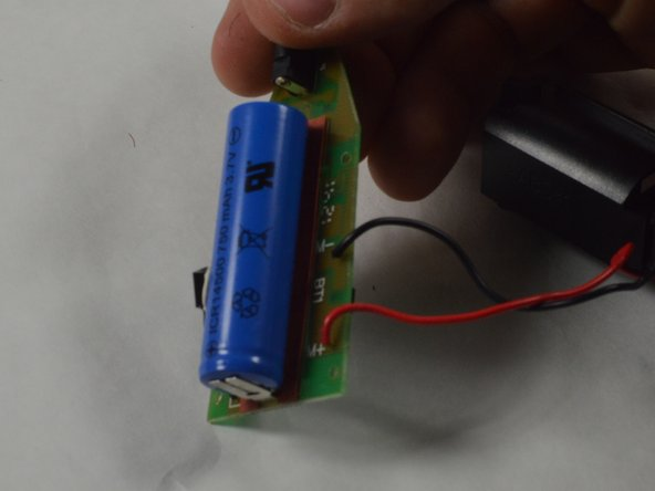 Soldering tabs hold the battery onto the motherboard.