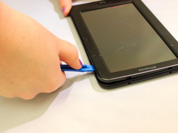 Lift the device off of the case and flip over the device so that it sits screen side down.