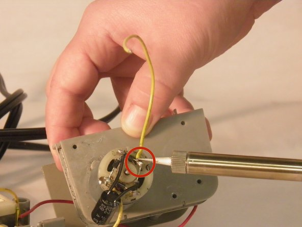Using a soldering iron, de-solder the sensor wire from the electric A/C motor.