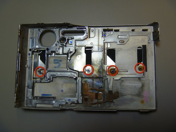 Remove four screws using Phillips located on the inside of the front cover.