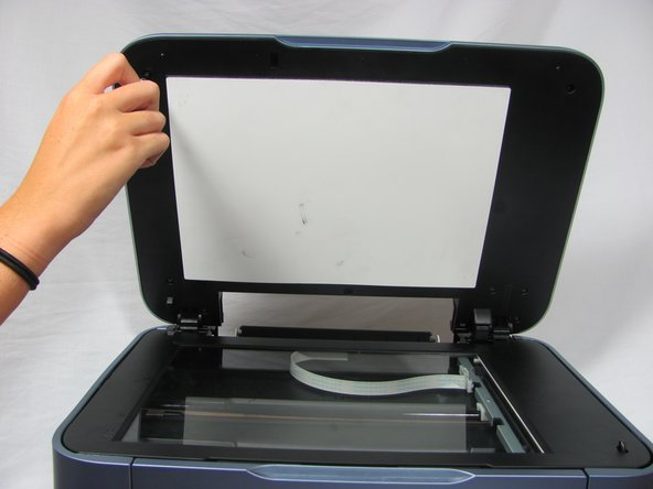 Open top lid of the printer to reveal the scanner