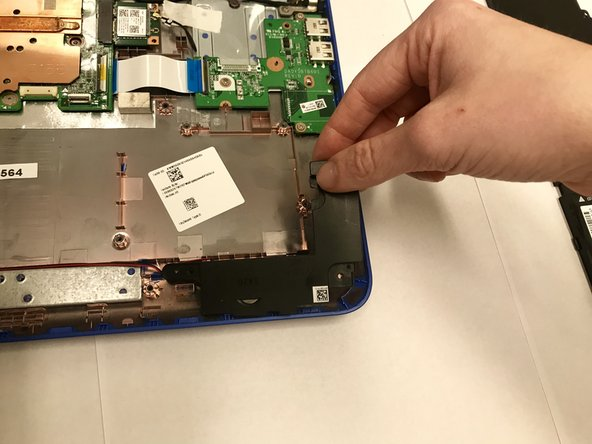 Carefully remove the right and left components of the battery out of the device.