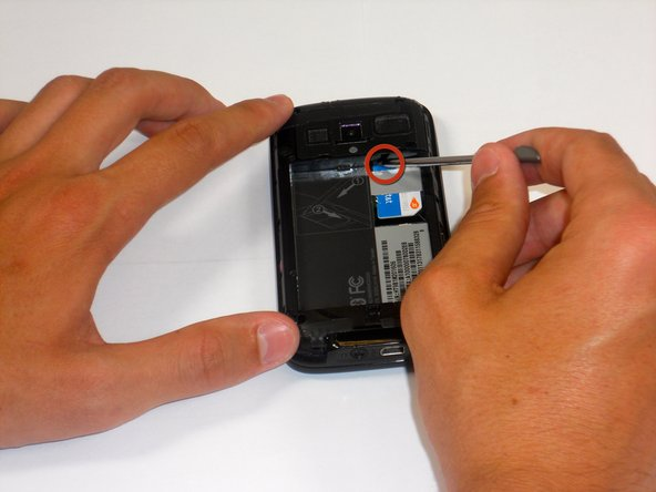 Slide out SIM card rest of the way with your finger.