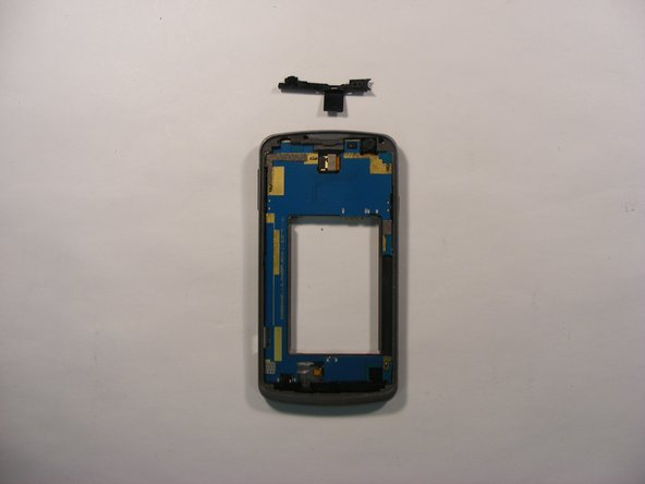 On the front side of the phone, push down on the top plastic shield to loosen it, and remove the shield using the plastic opening tool .