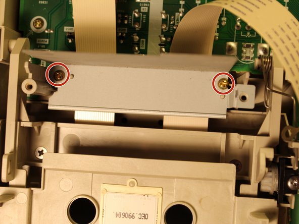 Remove the cassette deck (this is to access the screw beneath it)