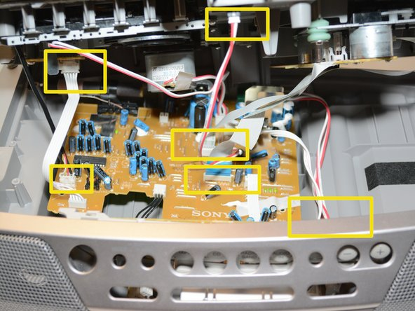 Image 1/1: This should include three sets of red and white wires, one set of white wires,  one set of black wires, and two ribbon wires. Some cannot be disconnected from the top piece of the radio. Disconnect these plugs from the circuit board.