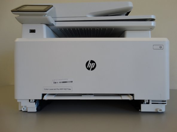 Remove the bottom tray by pulling it until it fully is out of the printer.