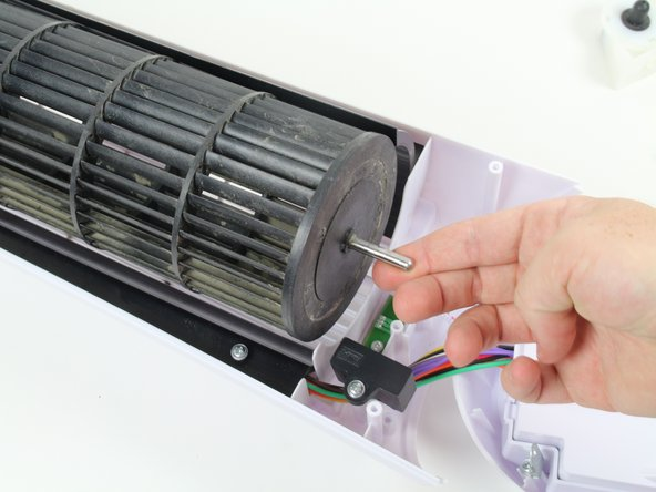 Return back to the top of the fan blade. Lift the fan blade to a slight angle and gently pull it towards you.