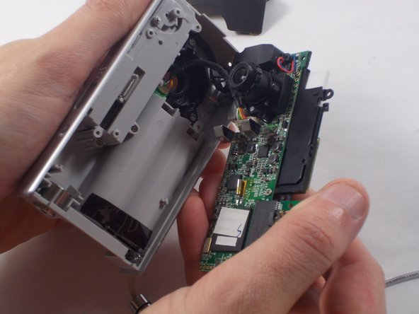 Gently separate the circuit board from the casing.